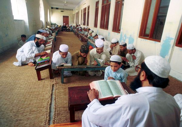 Students recite lines at a Madrassa in Pakistan